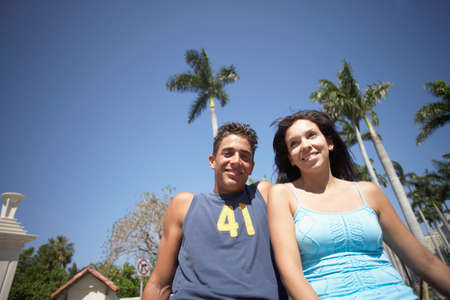 low  angle: Low angle view of multi-ethnic couple