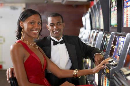 Couple next to slot machines Stock Photo