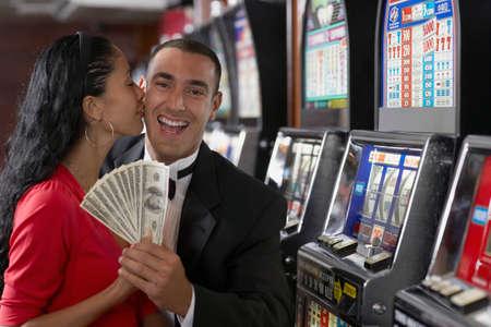 prevailing: Hispanic couple holding money
