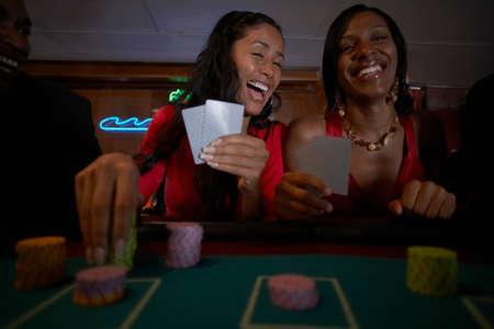 low spirited: Multi-ethnic women gambling
