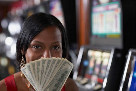 prevailing: Mixed Race woman holding money