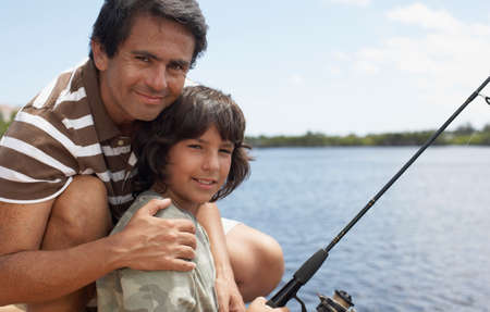 poppa: Hispanic father and son fishing