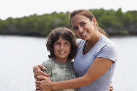 spectating: Hispanic mother hugging son LANG_EVOIMAGES