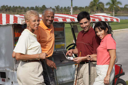 prevailing: Multi-ethnic couples at food stand on golf course