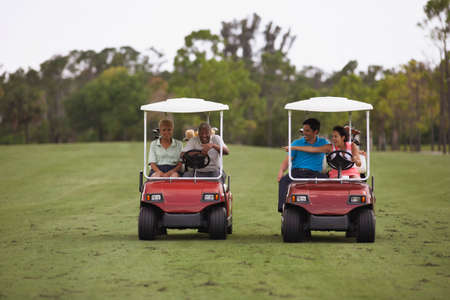 prevailing: Multi-ethnic couples racing golf carts