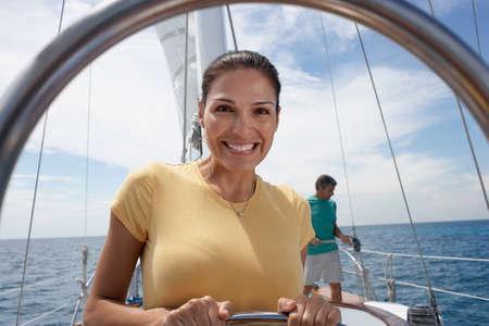 bathingsuit: Hispanic woman on sailboat LANG_EVOIMAGES