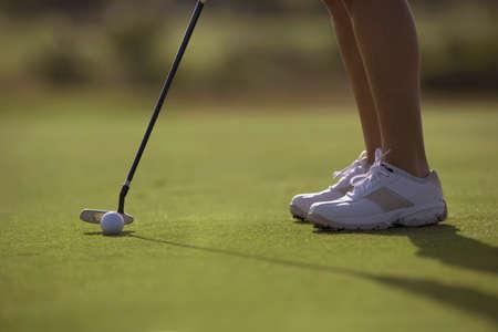 liveliness: Hispanic woman playing golf