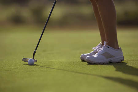 prevailing: Hispanic woman playing golf