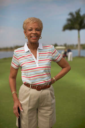 Senior African American woman on golf course Stock Photo