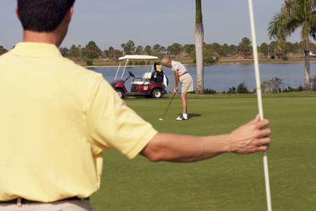 30 years old married couple: Multi-ethnic friends playing golf