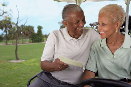 30 years old married couple: Senior African American couple in golf cart
