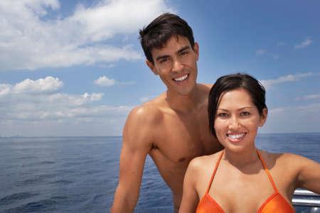 bathingsuit: Multi-ethnic couple next to water