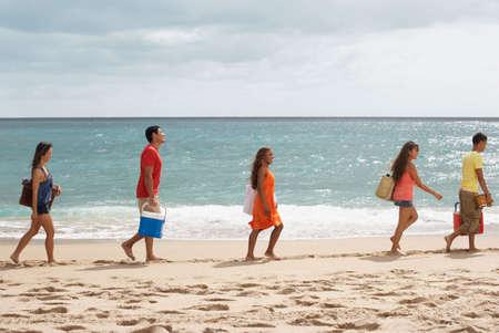 pacific islander ethnicity: Multi-ethnic friends walking on beach