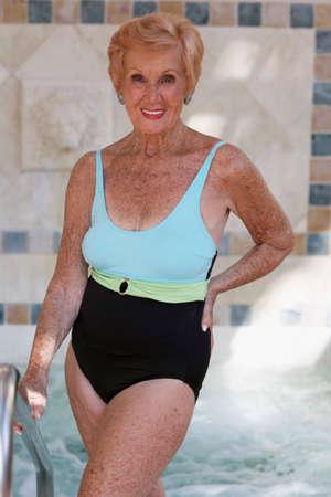 Senior woman wearing bathing suit LANG_EVOIMAGES