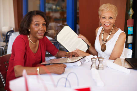 only seniors: Senior African American women at restaurant LANG_EVOIMAGES