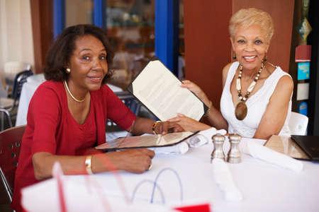 Senior African American women at restaurant LANG_EVOIMAGES