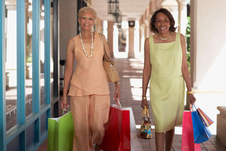 seventy two: Senior African American women carrying shopping bags