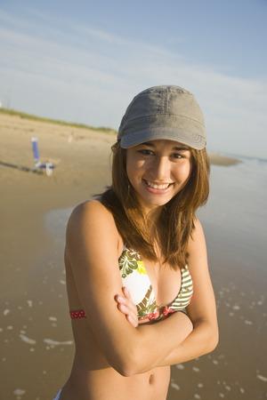 filipina: Asian girl wearing hat at beach LANG_EVOIMAGES