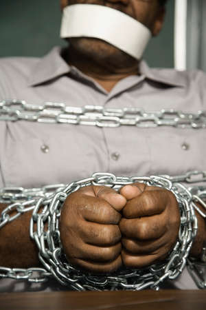 gagged: African American man chained and gagged