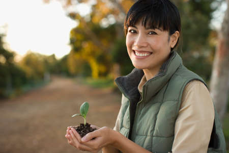 searcher: Asian woman holding small plant