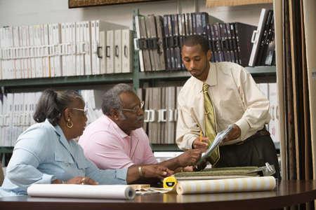 nite: African American couple looking at flooring samples