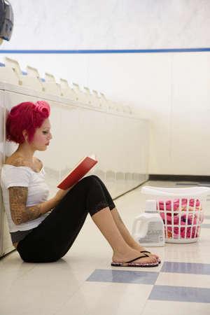 laundromat: Tattooed Hispanic woman in laundromat