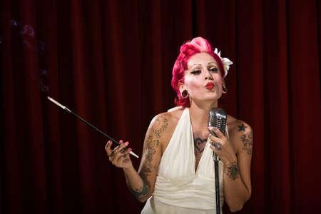 low spirited: Tattooed Hispanic woman on stage