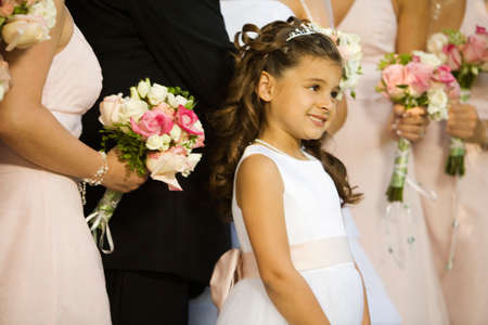 eveningwear: Hispanic flower girl at wedding LANG_EVOIMAGES