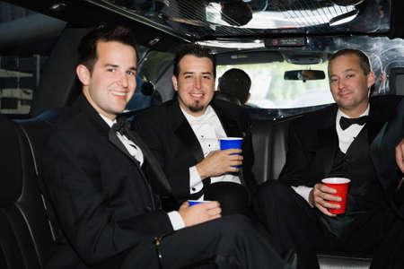 attired: Multi-ethnic men in tuxedos LANG_EVOIMAGES