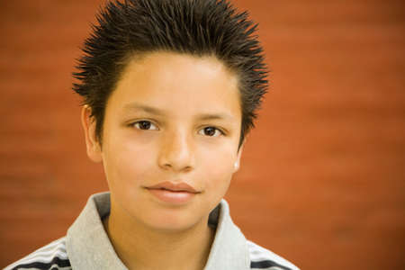 spiked hair: Hispanic boy with spiked hair