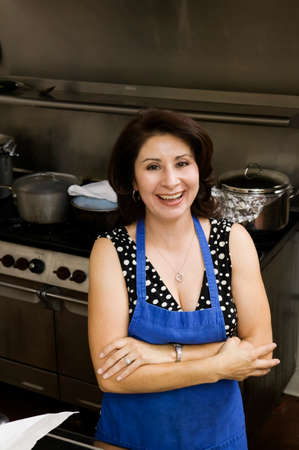 relishing: Hispanic woman in commercial kitchen