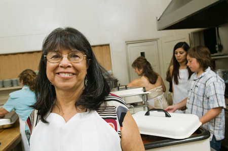 2 persons only: Hispanic woman wearing apron LANG_EVOIMAGES