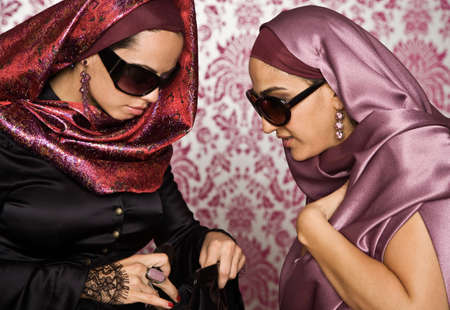 middle eastern: Middle Eastern women looking in purse