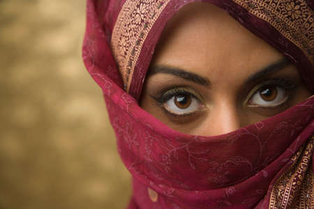 searcher: Middle Eastern woman wearing face covering