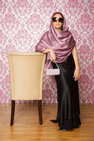 middle eastern: Middle Eastern woman wearing evening gown LANG_EVOIMAGES