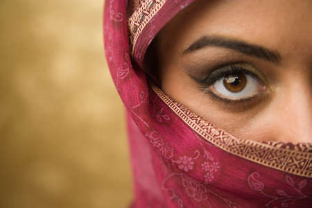 attired: Middle Eastern woman wearing face covering