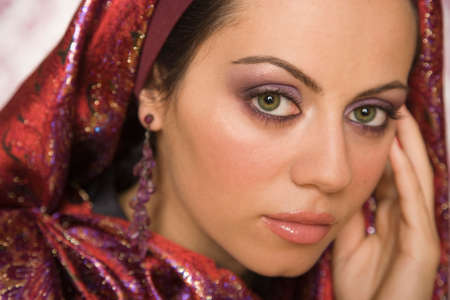 attired: Middle Eastern woman wearing head scarf LANG_EVOIMAGES