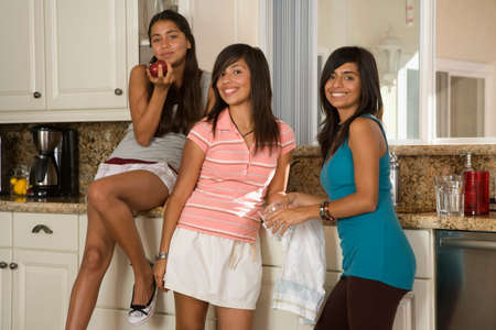 davenport: Hispanic teenaged girls in kitchen