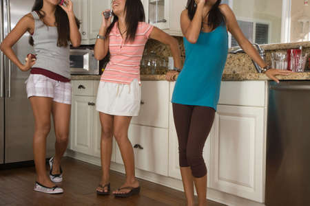 bathtowel: Hispanic teenaged girls in kitchen