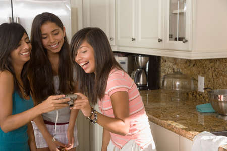 teenaged girls: Hispanic teenaged girls looking at camera LANG_EVOIMAGES