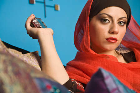 middle eastern: Middle Eastern woman holding cell phone