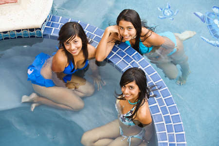 teenaged girls: Hispanic teenaged girls in swimming pool