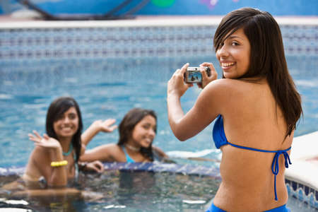 teenaged girls: Hispanic teenaged girls in swimming pool