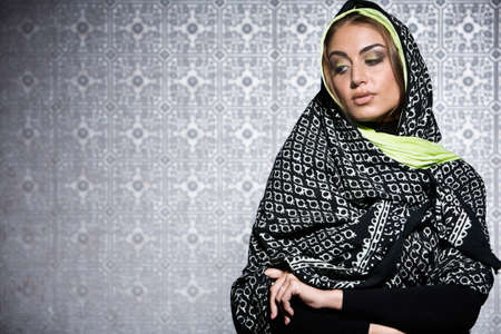 middle eastern: Middle Eastern woman wearing head scarf LANG_EVOIMAGES
