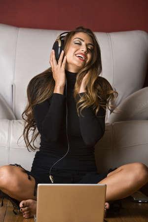 bathingsuit: Middle Eastern woman listening to headphones