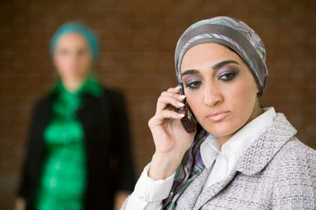 middle eastern: Middle Eastern businesswoman talking on cell phone