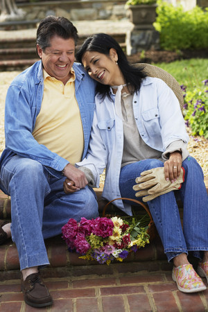 girl in full growth: Hispanic couple laughing LANG_EVOIMAGES