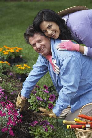 Hispanic couple gardening