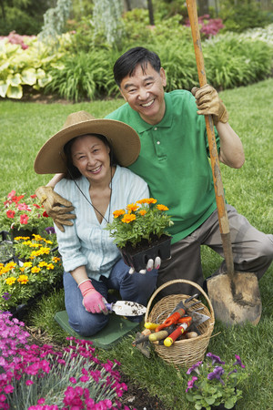 Senior Asian couple gardening