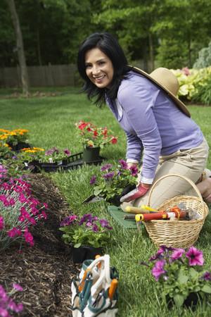 Hispanic woman gardening